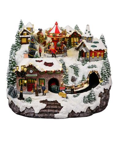 Image of Northern Winter Christmas Village Scene With Rotating Train & Carousel - 26cm